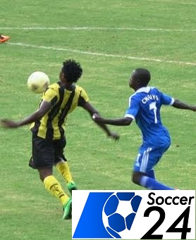 Chitiyo tussles for the ball with a AS Vita player