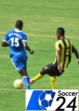 AS Vita player under pressure from Masimba Mambare