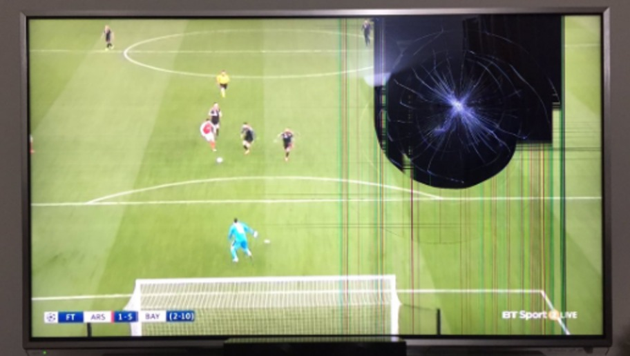PHOTO: Cracking Under Pressure! Arsenal Fan Smashes His Own TV Whilst Watching Gunners Capitulate