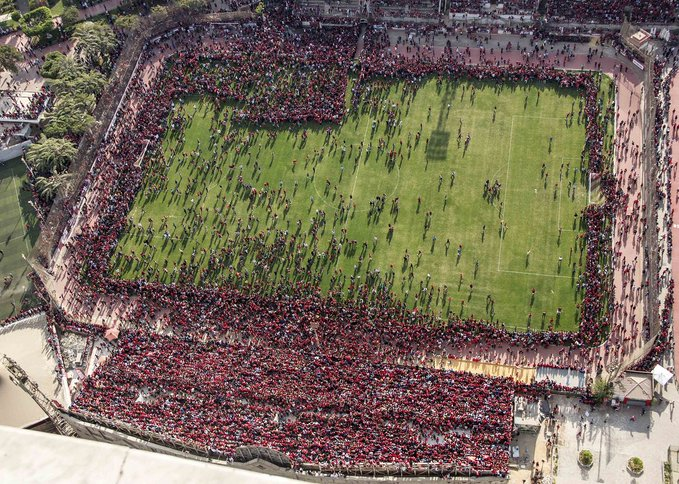 Thousands of Al Ahly fans swarm the pitch for training session