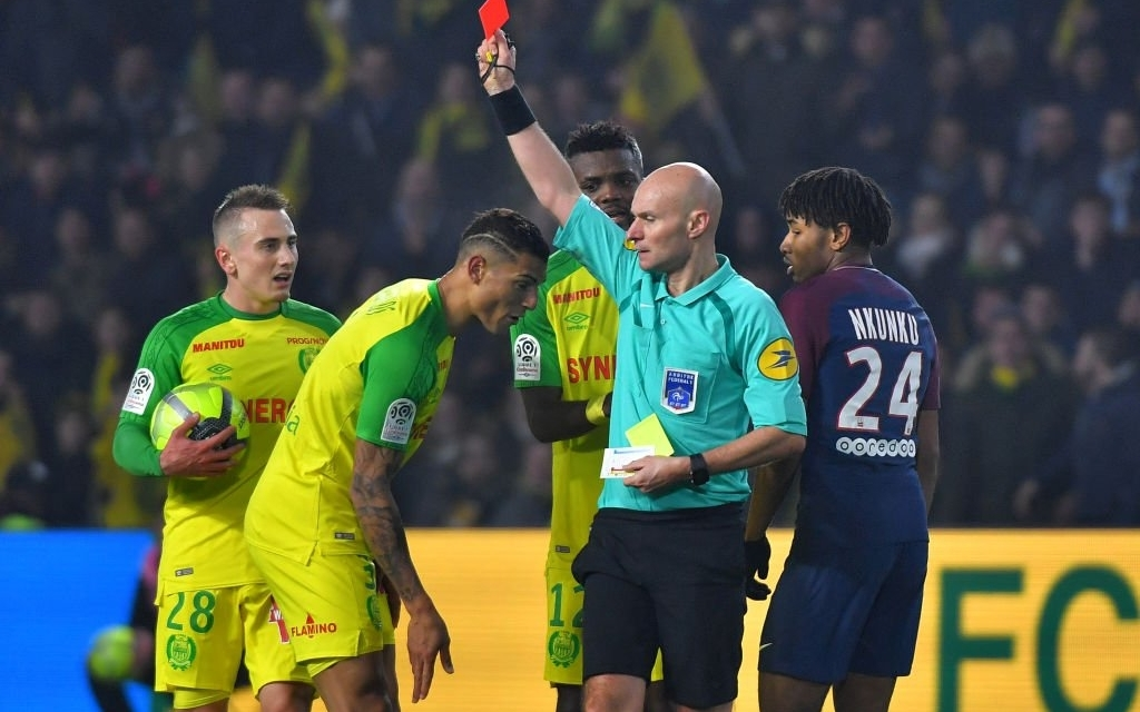 French referee banned after kicking player
